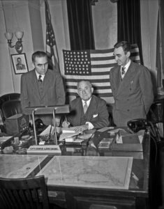 James Nolan of Wrangell, Frank Peratrovich of Klawock, and Gov. Ernest Gruening (seated) in Governor's office in Juneau signing the Alaska Income Tax Bill in 1949.