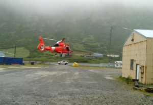 The Coast Guard arrives in King Cove to medevac a woman suffering from breathing difficulties on July 20, 2015.